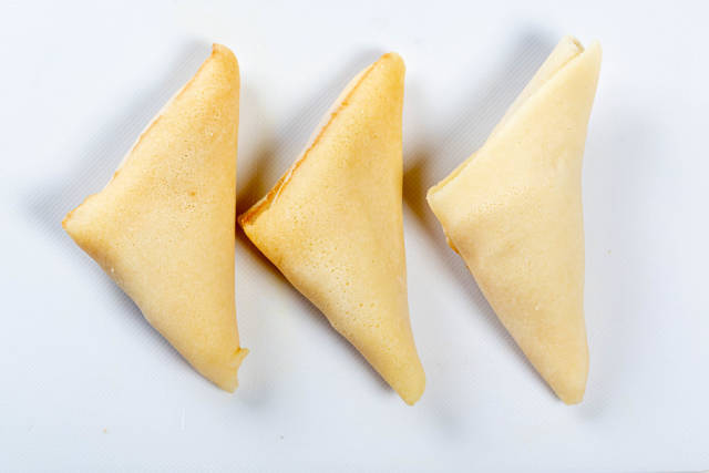 Triangle pancakes with stuffing. Top view