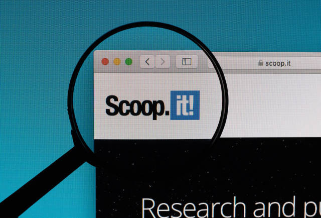 Scoop.it! logo under magnifying glass