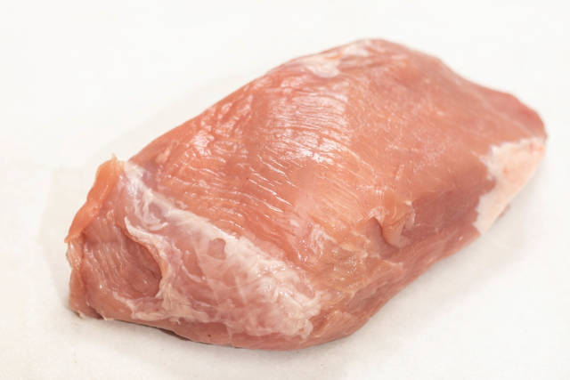 Isolated raw pork meat above white background