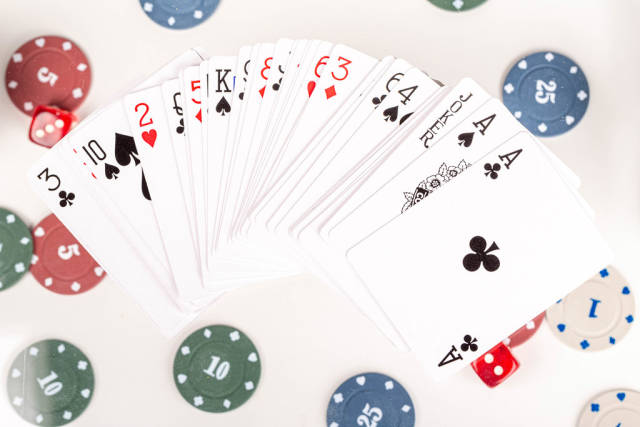A deck of poker cards on the background of playing chips