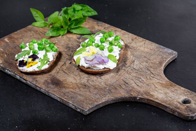 Cheese sandwiches with green peas, Basil leaves and flowers