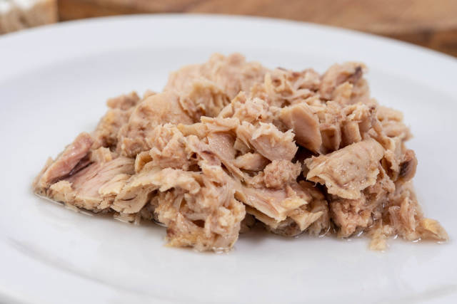 Canned Tuna Fish served on the white plate