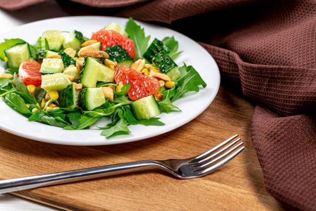 Diet salad with vegetables, grapefruit and nuts