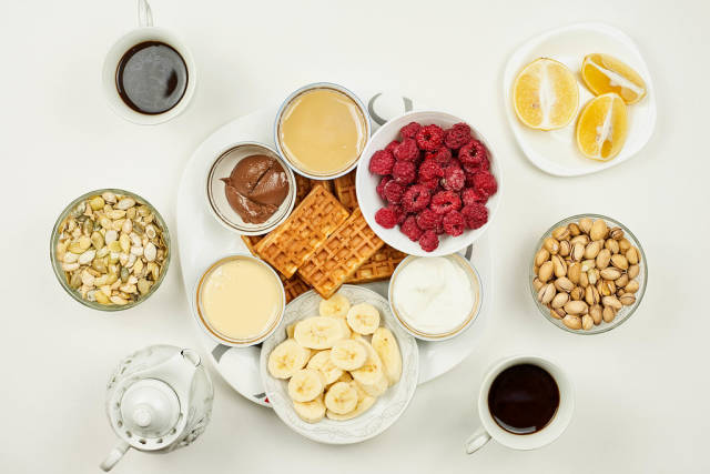 Directly above shot of breakfast on white background
