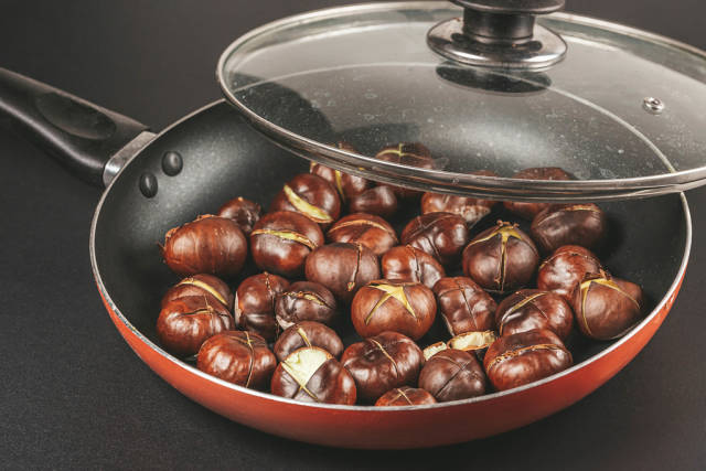 Frying pan with fried chestnuts