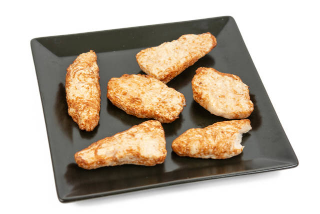 Chicken Breasts in Chilli sauce on the black square plate