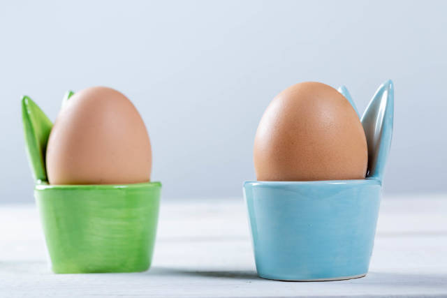 Boiled eggs in green and blue coasters