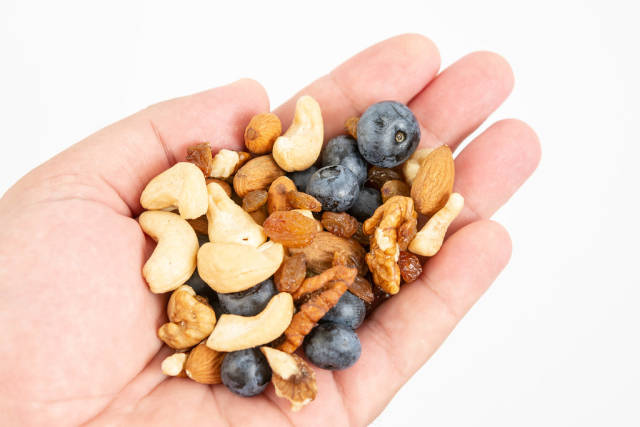 Crispbreads Blueberries Almonds Raisins and other in the hand