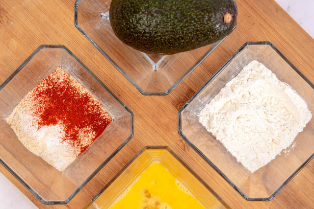 Flat lay above Avocado Flour Eggs and Breadcrumbs with Paprika