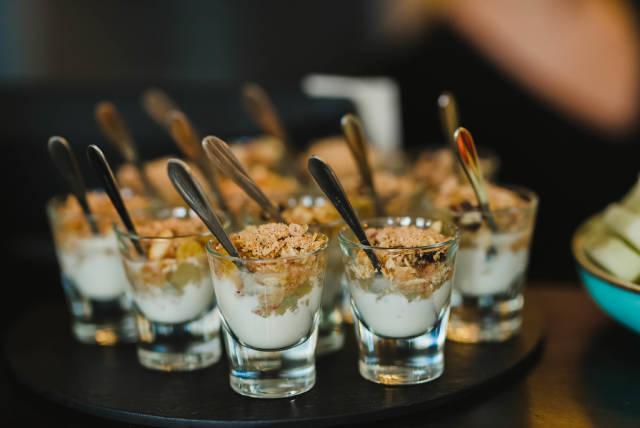 Musli And Cream Dessert On Glass Cups