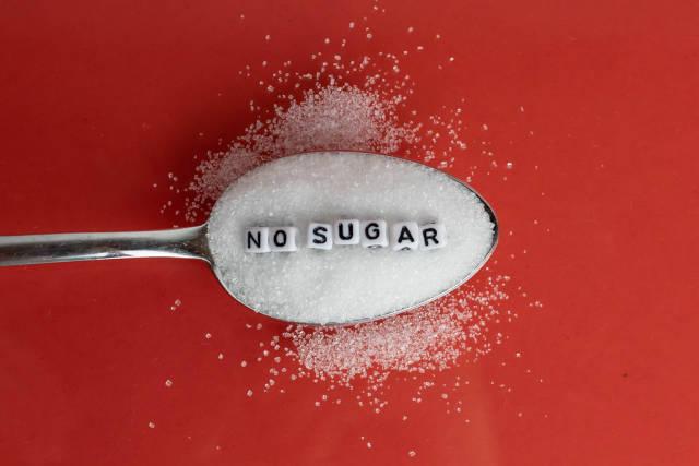 Ein Löffel Zucker mit den Worten : No Sugar