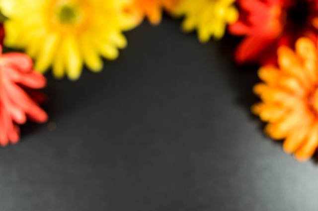 Blurry red, orange,  and yellow flower background