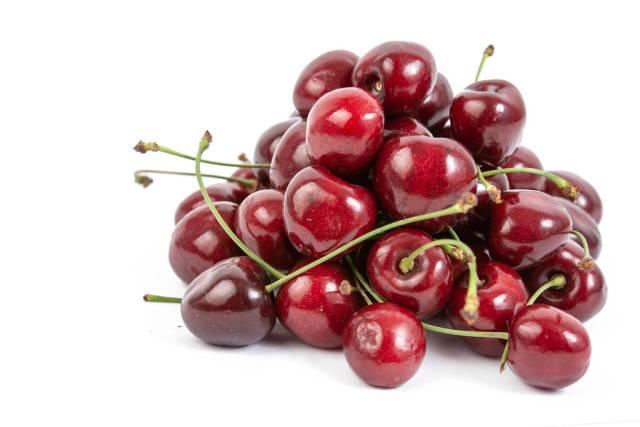 Fresh Cherries isolated above white background