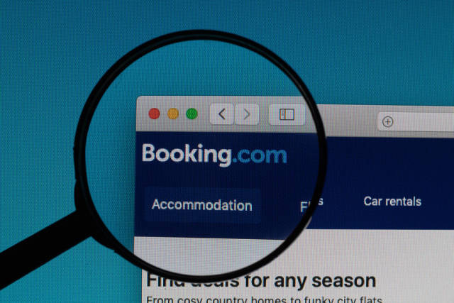 Booking.com logo under magnifying glass