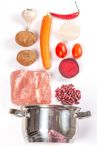 Metal pot and ingredients for cooking borscht