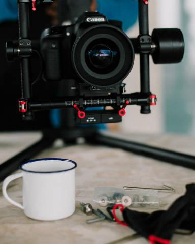 Close Up Shot of Coffee Mug and Camera on a Stabilizer