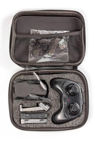 Black drone quadcopter with a remote control in case