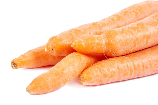 Fresh Raw Carrots on the white background