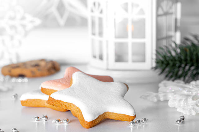 Close-up of gingerbread on Christmas background