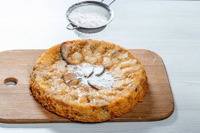 Ready homemade apple pie sprinkled with powdered sugar