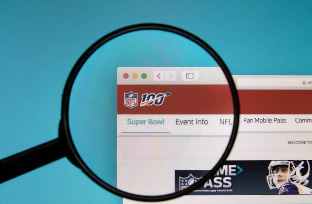 NFL logo on a computer screen with a magnifying glass