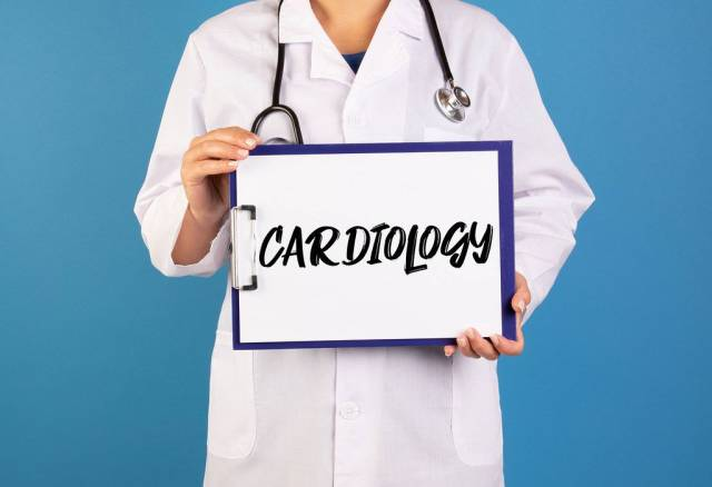 Doctor holding clipboard with Cardiology text