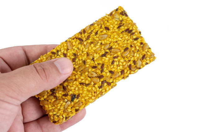 Protein Curcuma Cereals Crackers in the hand