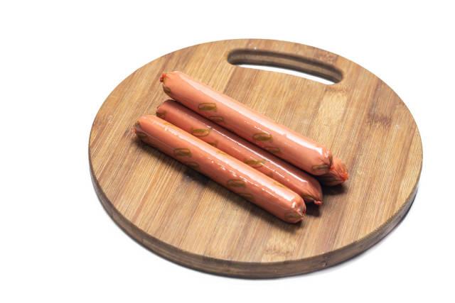 Raw hot dog Frankfurters on the wooden board