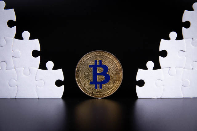 Puzzle pieces with golden Bitcoin coin