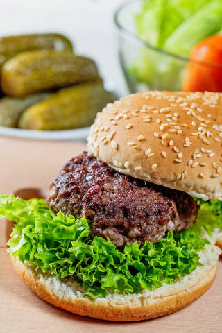 Burger with a large cutlet and lettuce