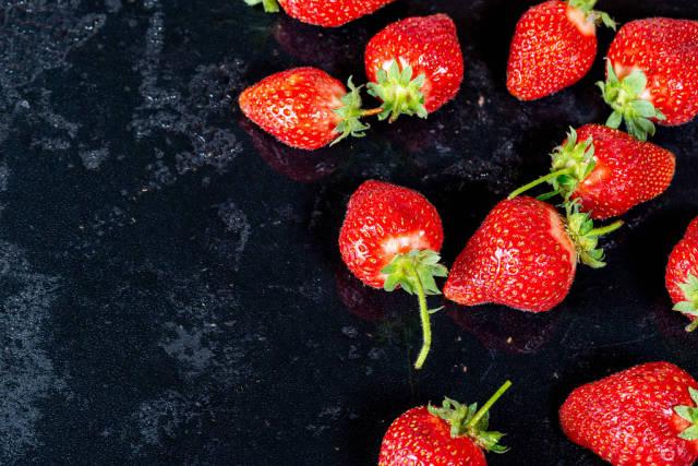 Fresh ripe strawberry on black background