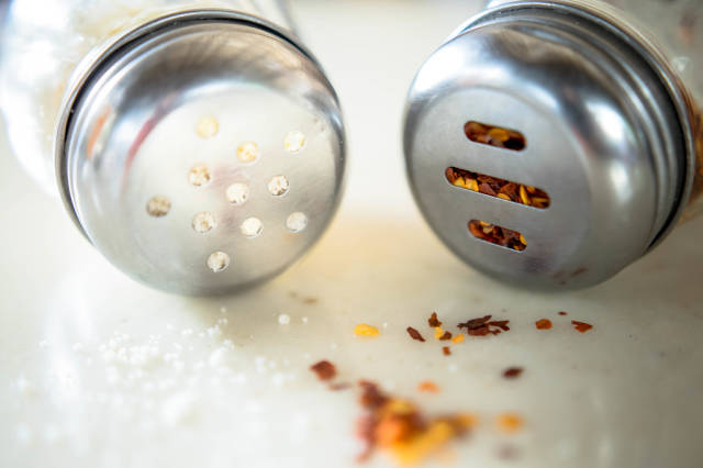 Parmesan cheese and dried chili shakers