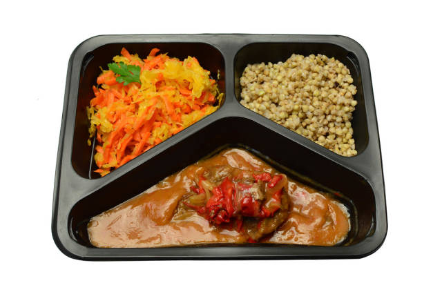 Cabbage and carrot salad and beef groats in sauce