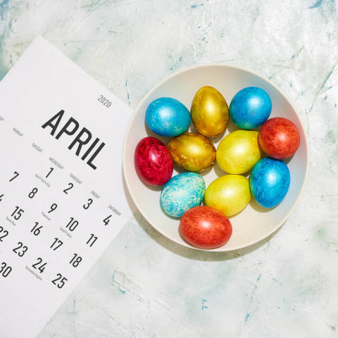 April calendar and a plate of Easter eggs