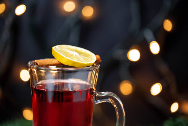 A glass of mulled wine on a background of Golden bokeh