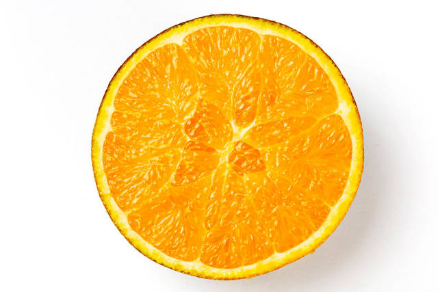 Top view, half of a chocolate orange on a white background
