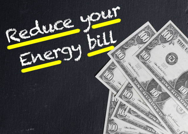 Reduce your Energy bill text with US dollar banknotes