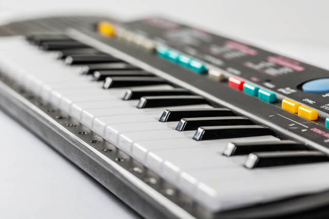 Electronic piano keyboard with black and white.