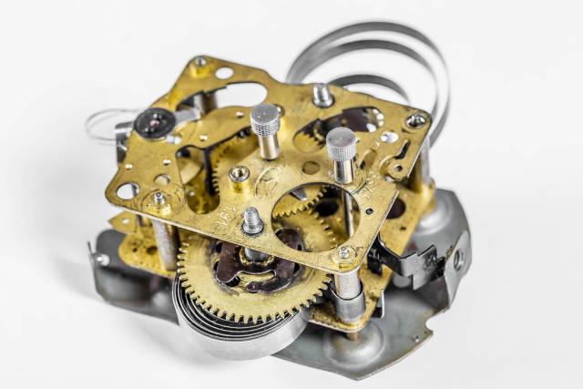 Gears and cogs in old vintage retro mechanism macro closeup