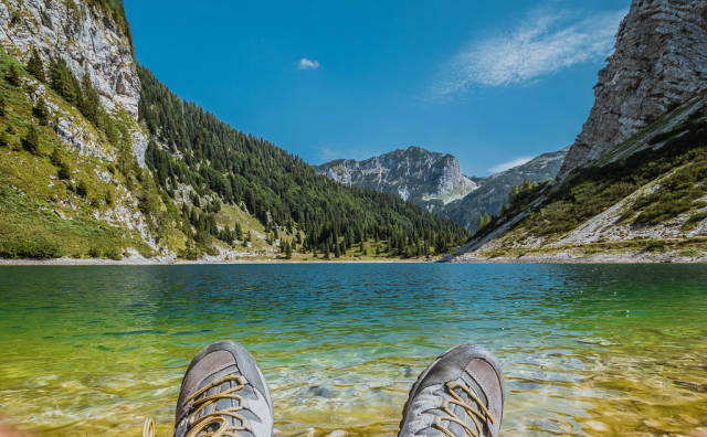 Man sitting on the beach of Krn lake