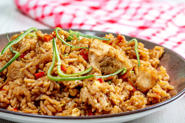 Close up of chinese rice with chicken and vegetables