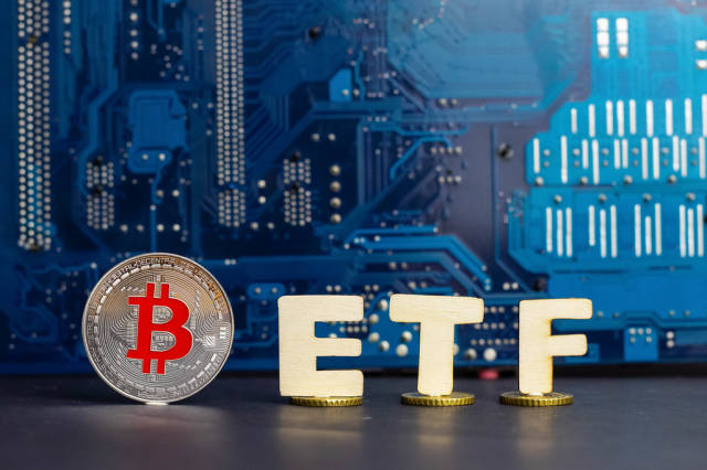 Concept of Bitcoin and ETF - on Coins with a motherboard in the background