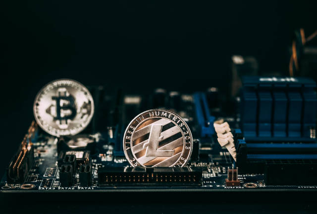 Litecoin and Bitcoin on motherboard