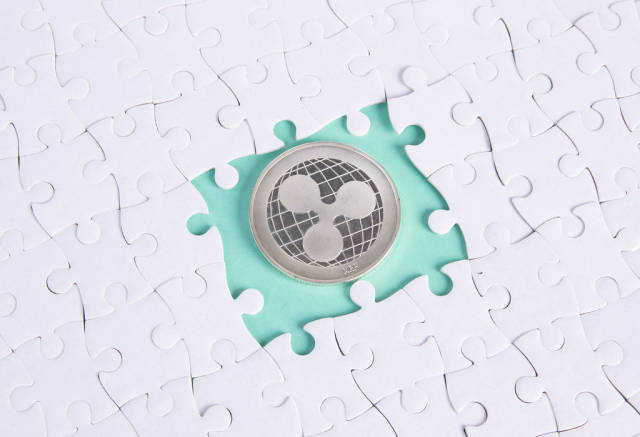 Missing puzzle pieces and silver Ripple coin