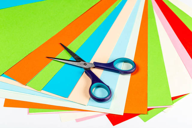 Colored paper and scissors - the concept of childrens needlework
