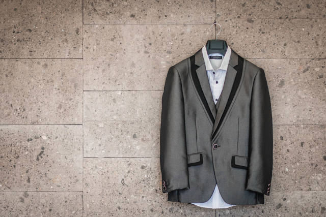 Grooms Suit hanging on a wall