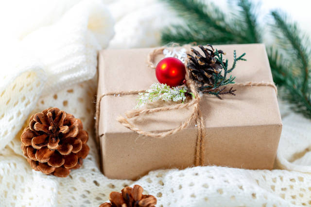Gift box on a white knitted blanket