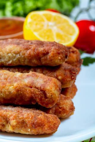 Fried fish sticks with crispy crust close-up