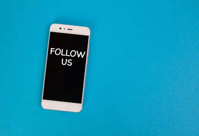 Follow us text on mobile phone