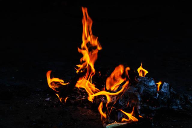 Orange fire flames on dark background